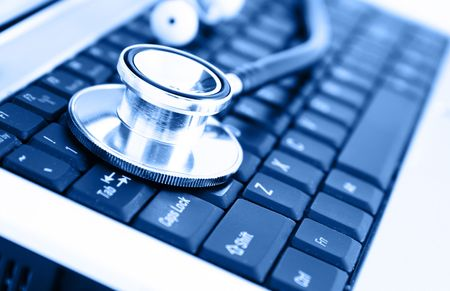 medical personal: Close-up of stethoscope on laptop keyboard Stock Photo