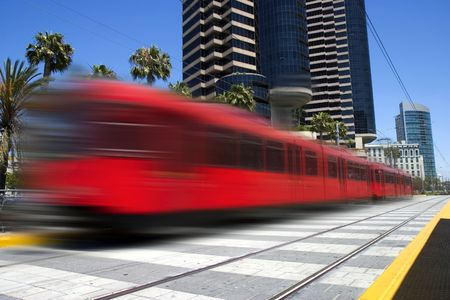 Beautiful red trolley moving fast through downtown 免版税图像