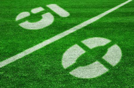 yardline: The fifty yard line on an american football field - diagonal view