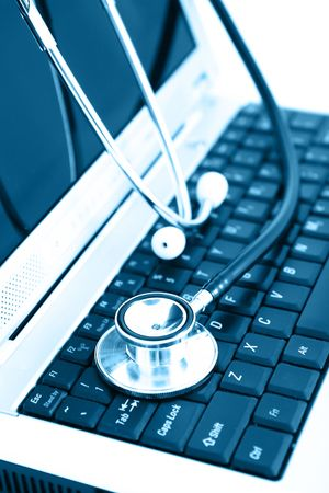 Technology and medicine - Silver stethoscope over laptopkeyboard Stock Photo