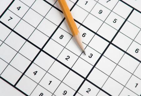 sudoku: pencil on sudoku grid Stock Photo
