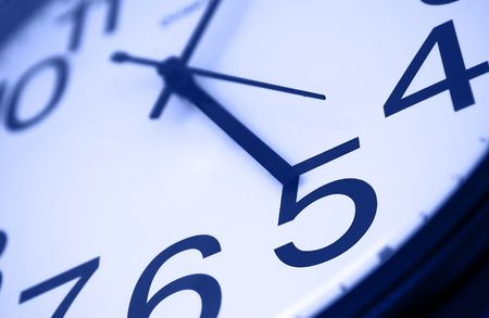 Five o clock - detail of wall office clock showing its time to go home. Selective focus on number 5, blue tint photo