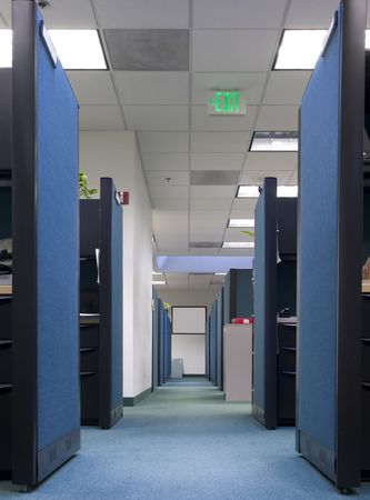 impersonal: Long row of empty office cubicles