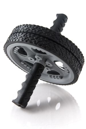 Isolated ab wheel, with slight reflection, most of the wheel in focus