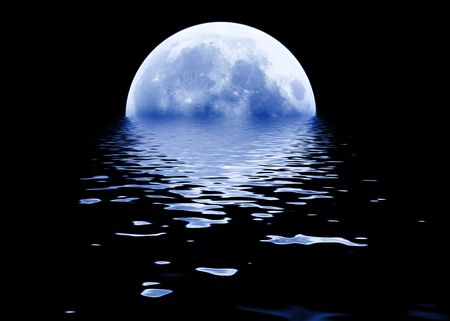rising: Full blue moon rising about calm waters Stock Photo