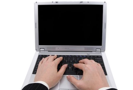 Hands of businesswoman typing on a laptop, isolated on white