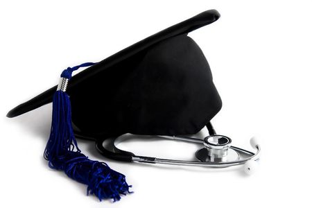 medical school: Black graduation cap with stethoscope isolated on white background Stock Photo