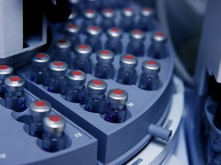 analytical chemistry: Capped vials on an analysis autosampler - selective focus