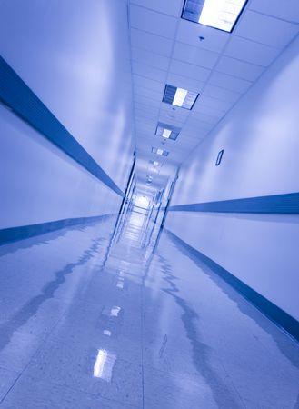 Slanted view of long blue corridor