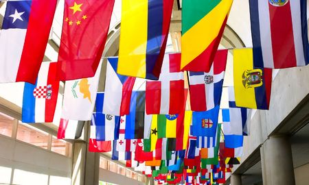 Flags of the world displayed at a convention center Stock Photo