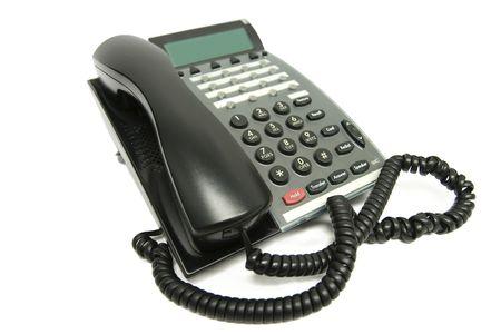 repondre au telephone: Moderne de bureau multi-t�l�phone, isol� sur blanc. Vue de c�t�, Focus sur le bouton