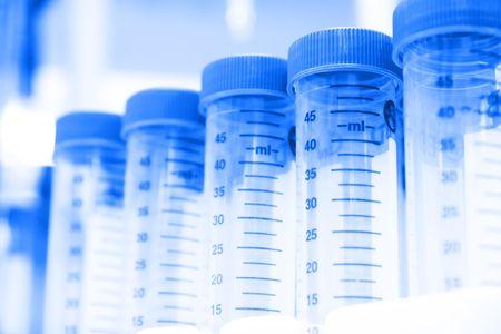 centrifuge: Row of centrifuge tubes on laboratory bench. Selective focus, blue tint