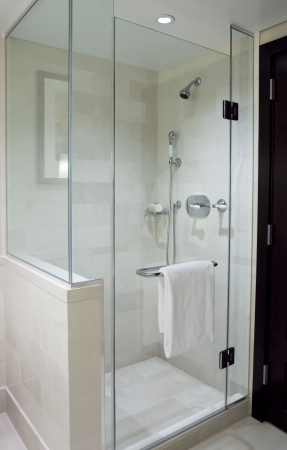 bathroom faucet: Shower with glass doors