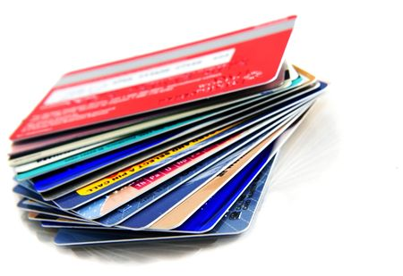 business cards: Stack of colorful credit cards with small reflection