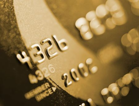 Close-up of silver digits on a credit card.  Very shallow depth of field, focus on number 2.  You can see the texture of the card in the in-focus areas.  Standard-Bild
