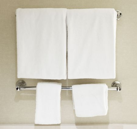 washcloth: White towels hanging on towel rack