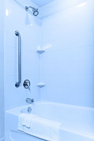 Handicaped and senior-accessible tub and shower in a modern apartment or hotel photo