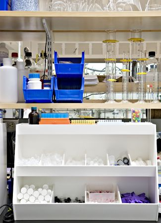reagents: Typical chemistry lab bench, with many supplies and reagents on the shelves