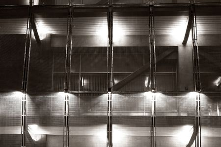 Grim prison walkway with protective mesh and security lights photo