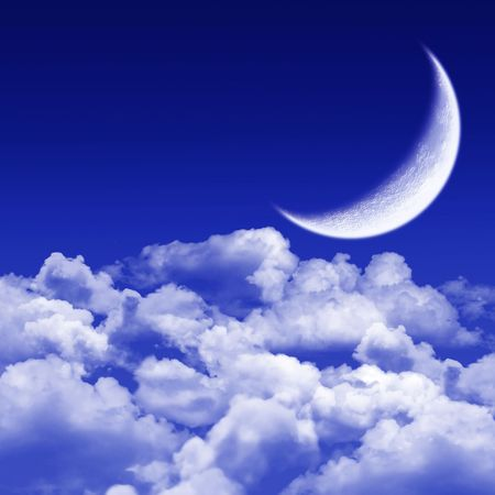 New moon  shining above blue clouds