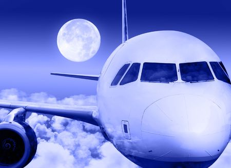 Close-up of aircraft in flight above clouds with full moon in the background