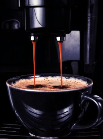 sophistication: Modern automatic espresso machine pouring the perfect cup of black coffee.  Slick dark lighting to match the cup and machine coloring and convey sophistication.