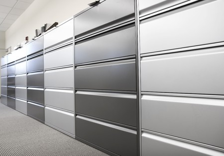 office cabinet: Long row of large filing cabinets in an office or hospital