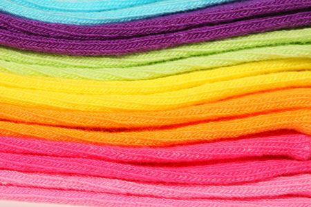 Close-up of a stack of new colorful cotton socks with excellent texture detail 免版税图像