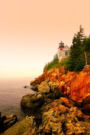 nautical structure: Lighthouse in Bass Harbor, Maine, at sunset Stock Photo