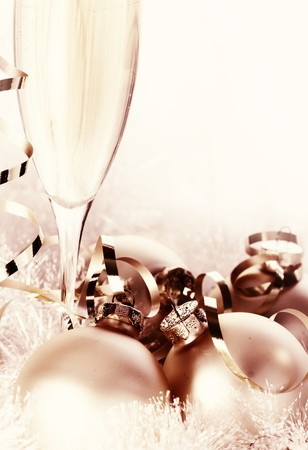 Glasses of champagne and Christmas ornaments  Stock Photo