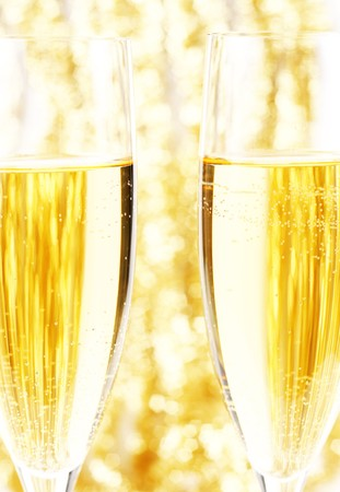 Champagne glasses on a background of golden lights Stock Photo
