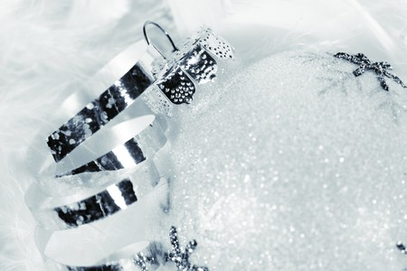 Frosted Christmas bauble with silver curly ribbon in luxurious snow-white feathers Stock Photo