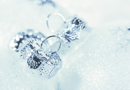 Frosted Christmas baubles in luxurious snow-white feathers
