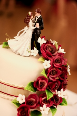 groom figures on a wedding cake. photo