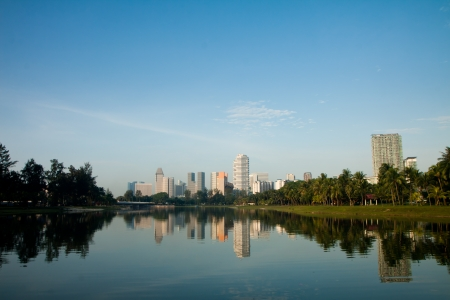 View of city buildings from a city park. Stock Photo - 14532470