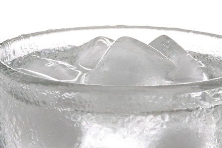 cooled: Glass of fresh water cooled with ice cubes.