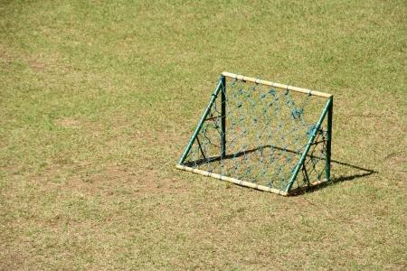 goal post: A mini soccer goal for kids on a mini soccer field.