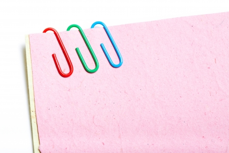 paper clips: Recycled notes pinned together with paper clips.