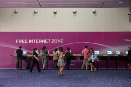 Changi International Airport, Singapore, March 25, 2010  The airport offers free internet services throughout the airport, both for people who bring their own device or not  Stock Photo - 14514615
