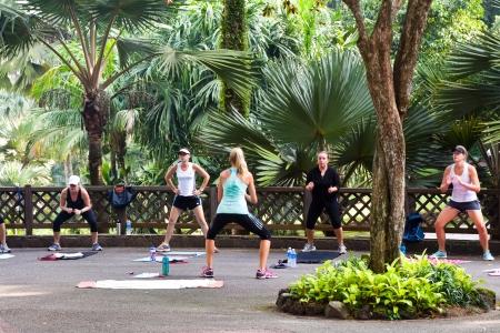 botanic: Group of women exercising in the morning at Singapore Botanic Garden.