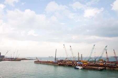 barrage: Port construction near Marina Barrage Reservoir, Singapore.