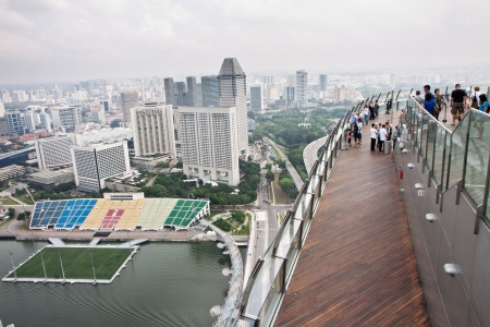 urbanized: View of Singapore cityscape from Public Observation Deck of Marina Bay Sands Resorts Hotel. Editorial