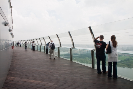 glass fence: Public Observation Deck at the top of Marina Bay Sands Resorts Hotel.