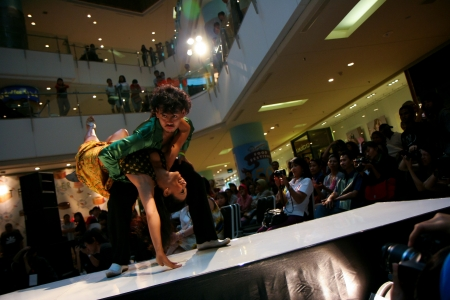 concluding: Jakarta, November 8, 2009. Tango performance by male and female dancers in Jak-Art 2009 event in Grand Indonesia Mal.