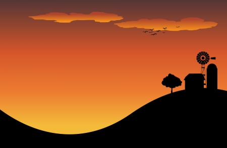 Silhouette of a farm house on top of a hill in the sunset  Or sunrise