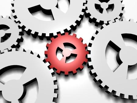 Een kleine rode tandwiel afbeelding van een sleutel, belangrijk onderdeel van een systeem. Stockfoto