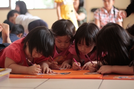playgroup: INDONESIA, LEMBANG, 25th December 2010. Children doing drawing and coloring activity in Kindergarten class.