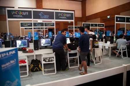 indo: Jakarta, Indonesia, 8th September 2013: Several competition participants playing video games on a video game competitions held in Indo Game Show 2013 at Jakarta Convention Center, Jakarta, Indonesia. Editorial