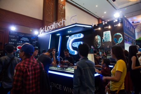 indo: Jakarta, Indonesia, 8th September 2013: Visitors trying out Logitech PC peripherals like keyboards, mouses, and headphones on Logitech stand in Indo Game Show 2013 event at Jakarta Convention Center, Jakarta, Indonesia.