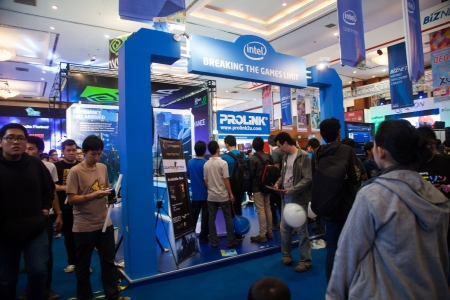 indo: Jakarta, Indonesia, 8th September 2013: Visitors crowding Intel stand in Indo Game Show 2013 expo at Jakarta Convention Center, Jakarta, Indonesia. Intel is leading microprocessor market for PC in Indonesia. Editorial